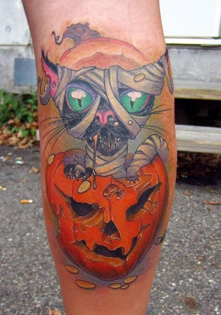 Creepy colored leg tattoo of mummy cat with pumpkin