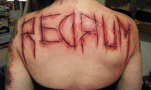 Creepy colored scars like bloody lettering tattoo on upper back