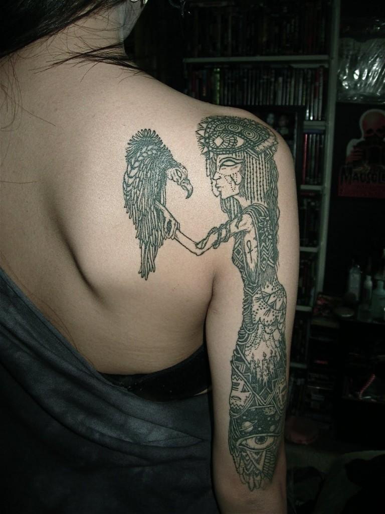 Creepy designed black ink fantasy witch tattoo on shoulder with bird