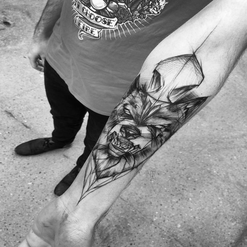 Creepy designed by Inez Janiak forearm tattoo of wolf head