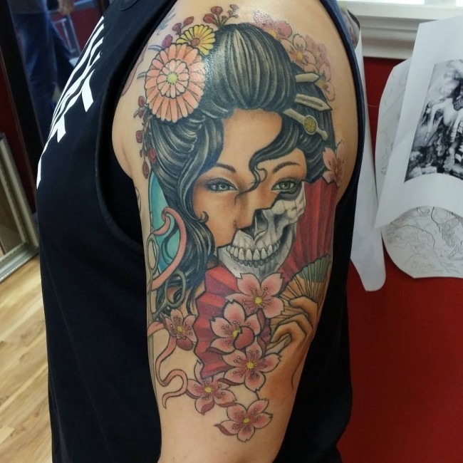 Creepy designed colored shoulder tattoo of Asian geisha tattoo with flowers