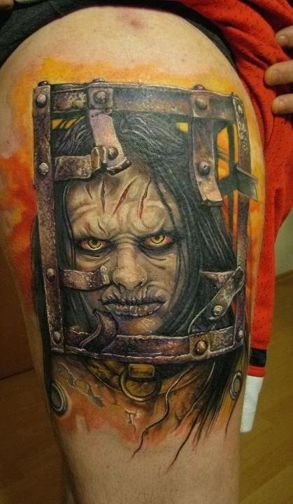 Creepy horror movie like female monster tattoo on thigh