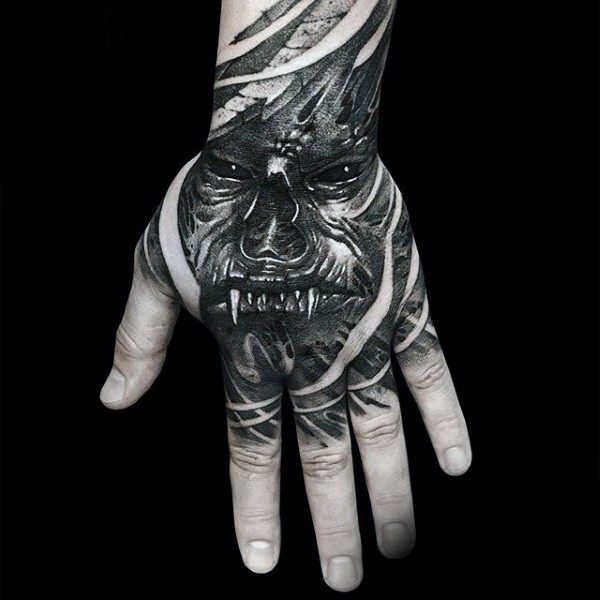Creepy horror style black ink hand tattoo of monster face