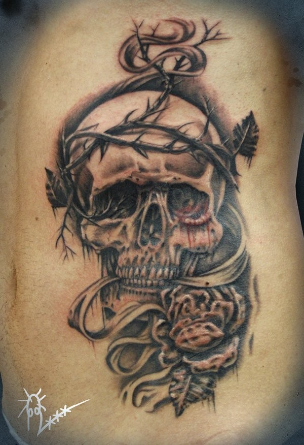 Creepy looking black and gray side tattoo of human skull with bine and bloody eye