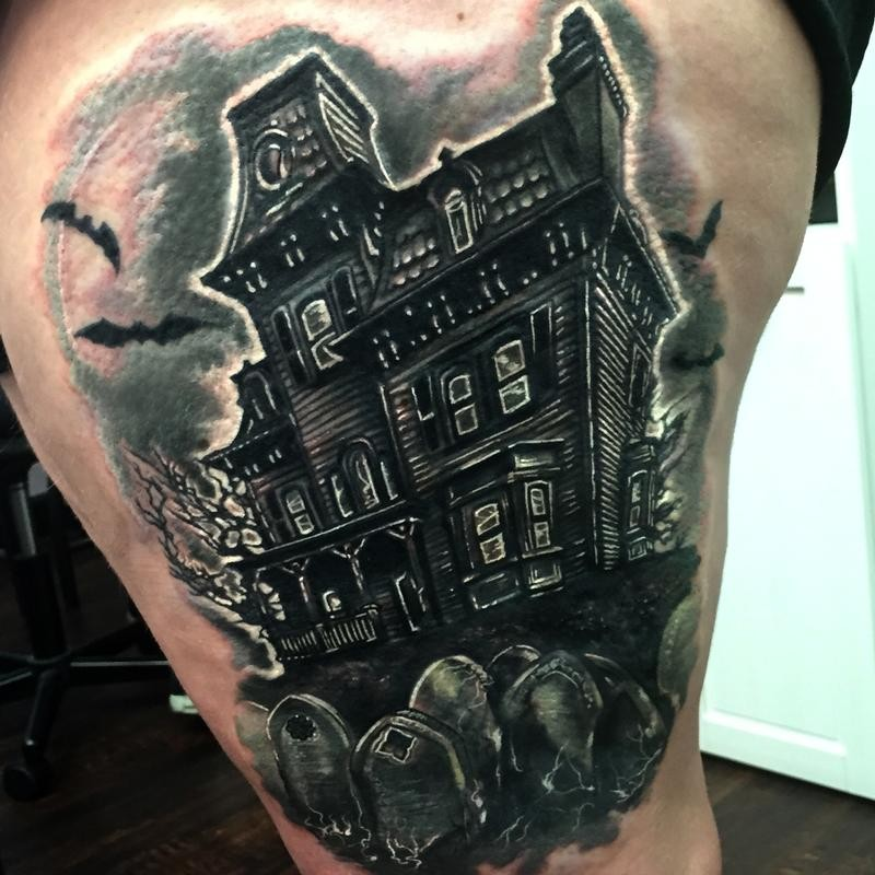Creepy looking black ink thigh tattoo of dark house and cemetery