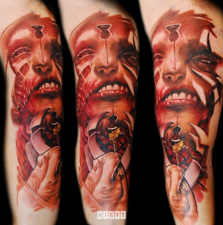 Creepy looking colored arm tattoo of mystical demonic face