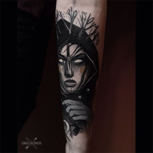 Creepy looking colored arm tattoo of woman face with moon and trees