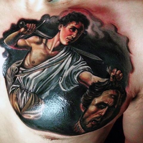 Creepy looking colored chest tattoo of man with severed demonic head