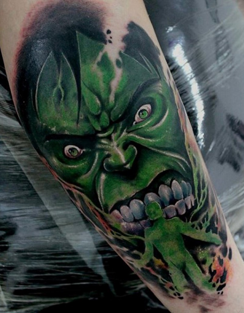 Creepy looking colored forearm tattoo of evil Hulk and green person