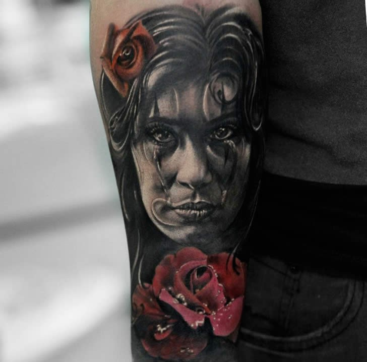 Creepy looking colored forearm tattoo of woman face with flowers