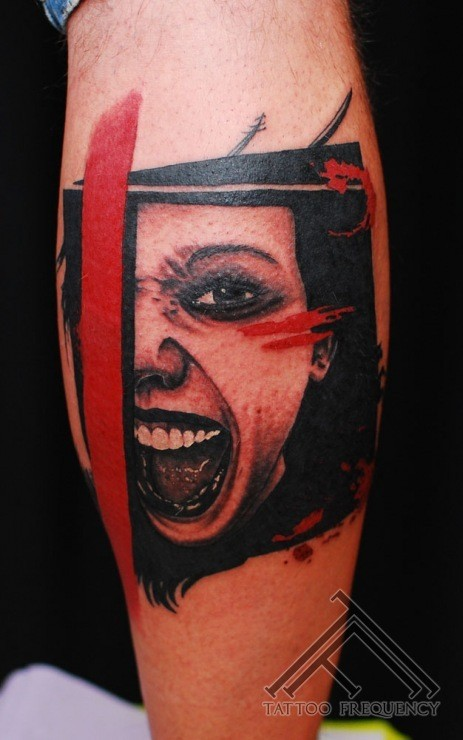 Creepy looking colored leg tattoo of screaming woman face