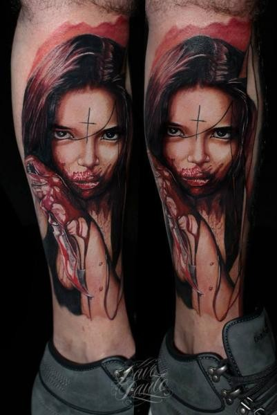 Creepy looking colored leg tattoo of bloody woman with knife