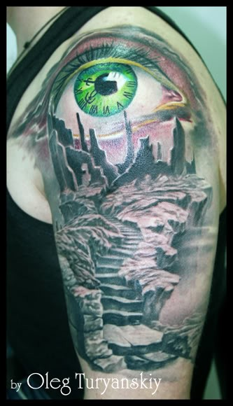 Creepy looking colored shoulder tattoo of mystic ruins and green eye