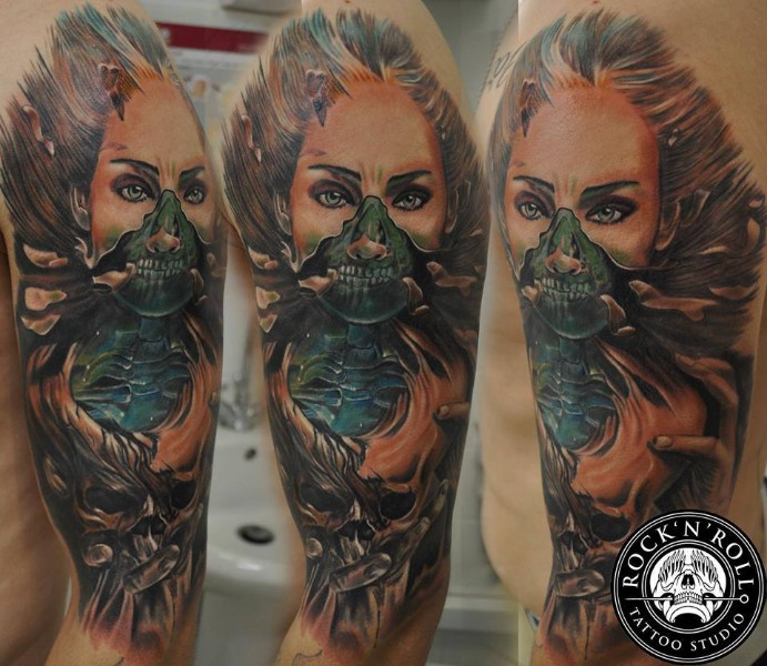 Creepy looking colored shoulder tattoo of monster woman face with skull