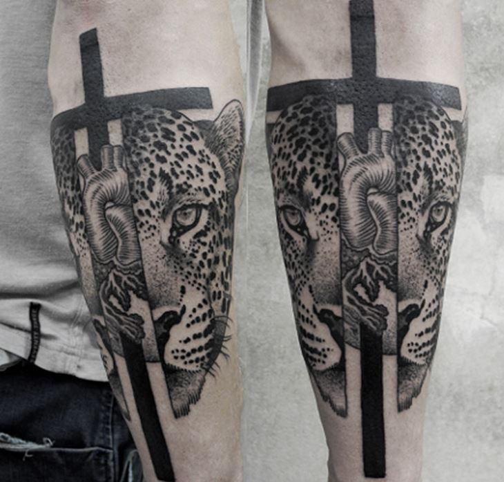 Creepy looking designed by Valentin Hirsch split tattoo of leopard head with human heart