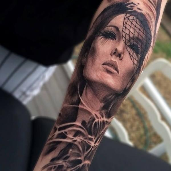 Creepy looking detailed arm tattoo of woman face