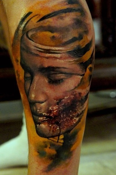 Creepy looking leg tattoo of bloody woman face