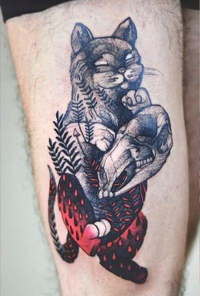 Creepy looking painted by Joanna Swirska tattoo of cat with animal skull