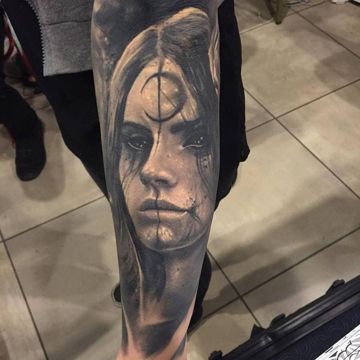 Creepy looking portrait style black ink leg tattoo of demonic woman portrait with symbol
