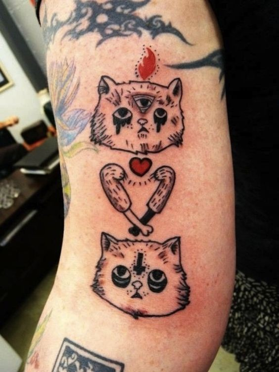 Creepy surrealism style colored arm tattoo of strange looking cat