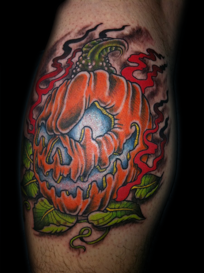 Creepy traditionally colored Halloween pumpkin with flames tattoo in 3D style