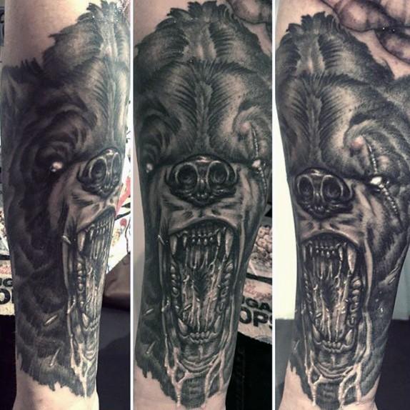 Creepy very detailed black ink demonic bear tattoo on arm