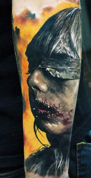 Creepy zombie like bloody female monster tattoo on arm