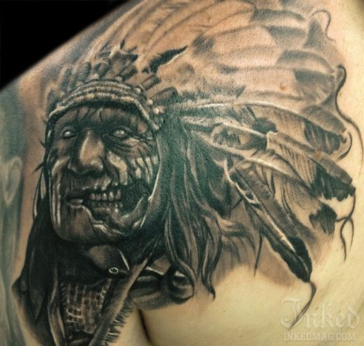 Creepy zombie like Indian chief tattoo on shoulder