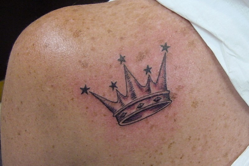 Crown with stars tattoo on upper back