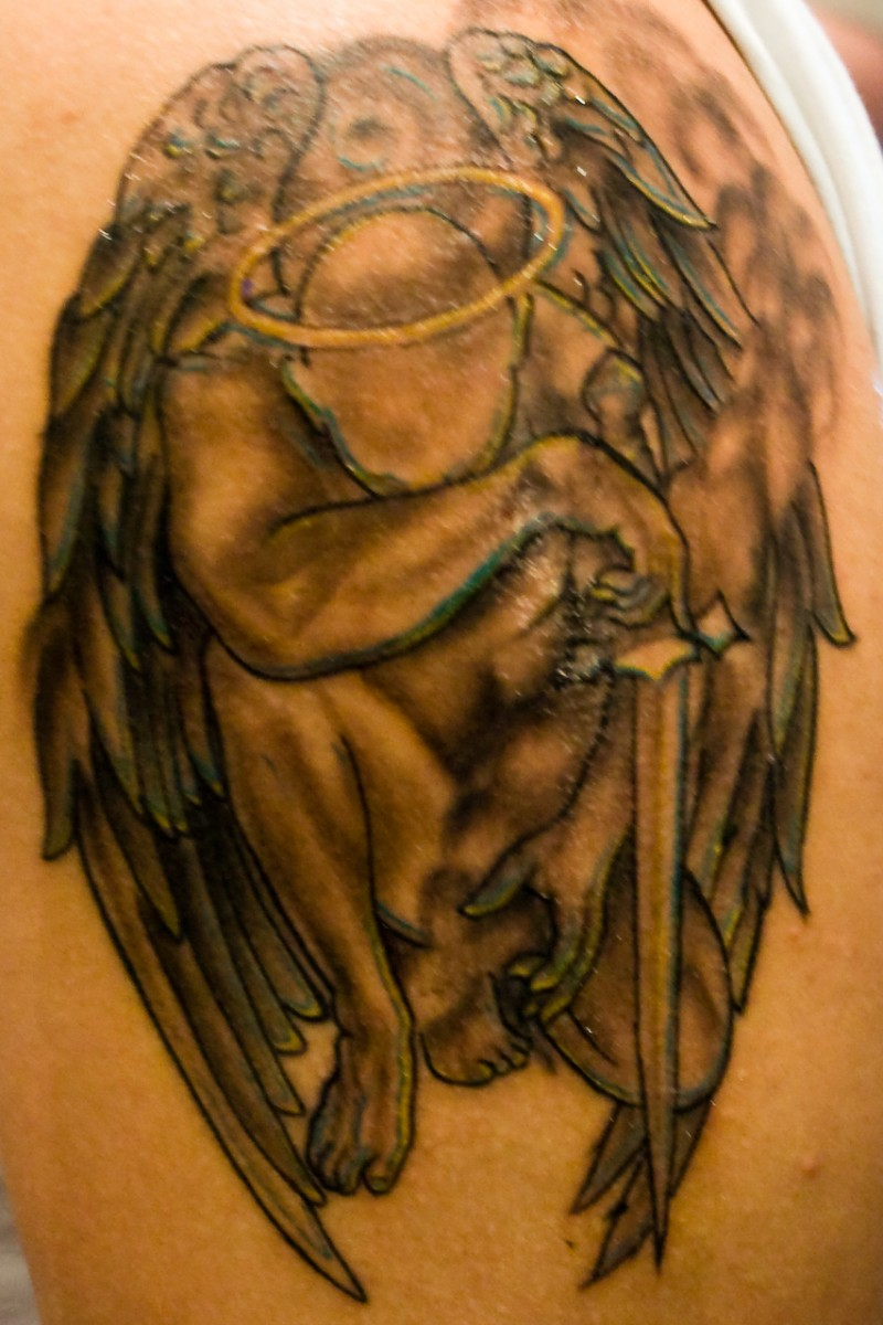 Crying angel with a sword tattoo
