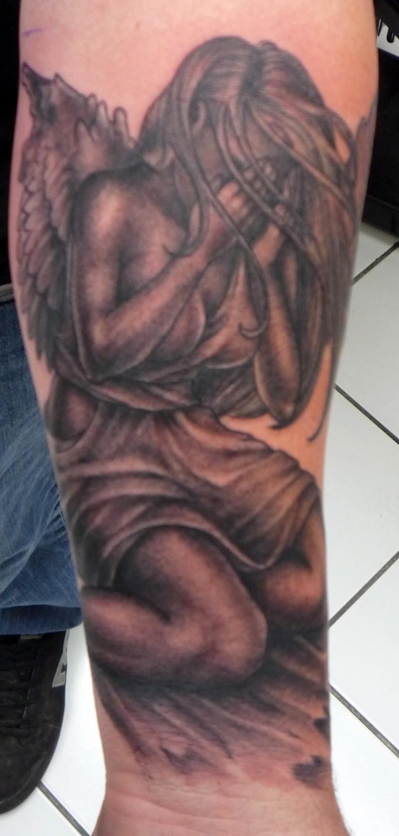 Crying girl angel tattoo on hand
