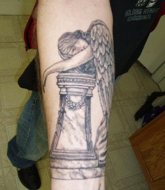 Crying on the postament angel tattoo