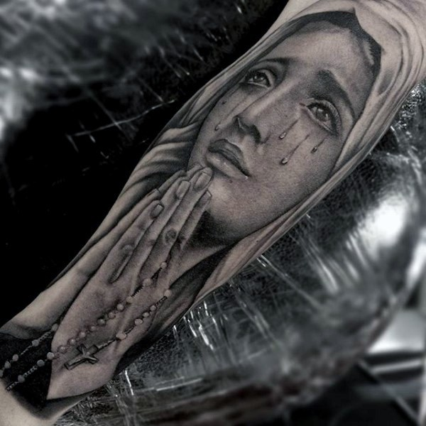 Crying Virgin Mary with chain cross in praying hands religious realistic forearm tattoo