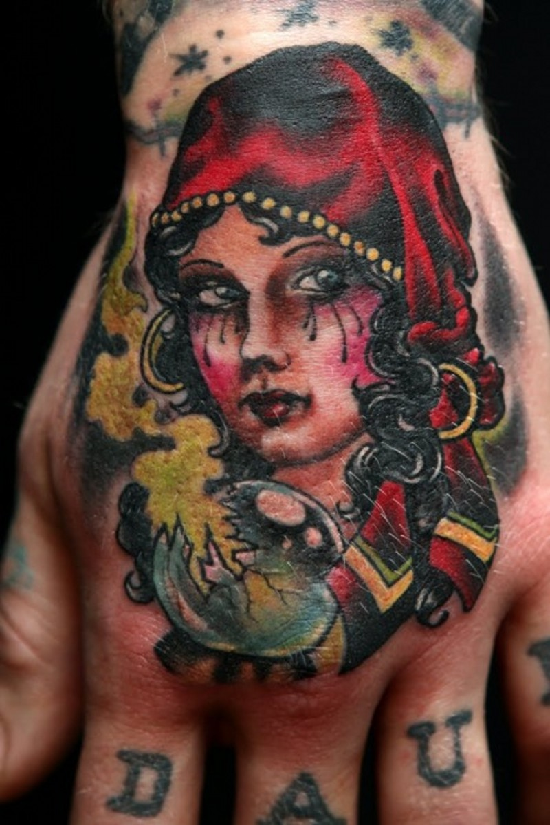 Crying young pretty Gypsy and broken magic ball traditional colored hand tattoo
