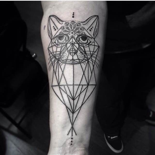 Cult style black ink forearm tattoo of cat head with geometrical figures