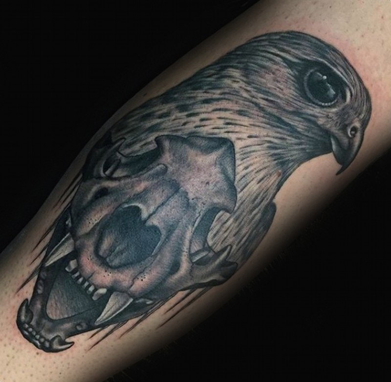 Cult style black ink leg tattoo of eagle head and animal skull