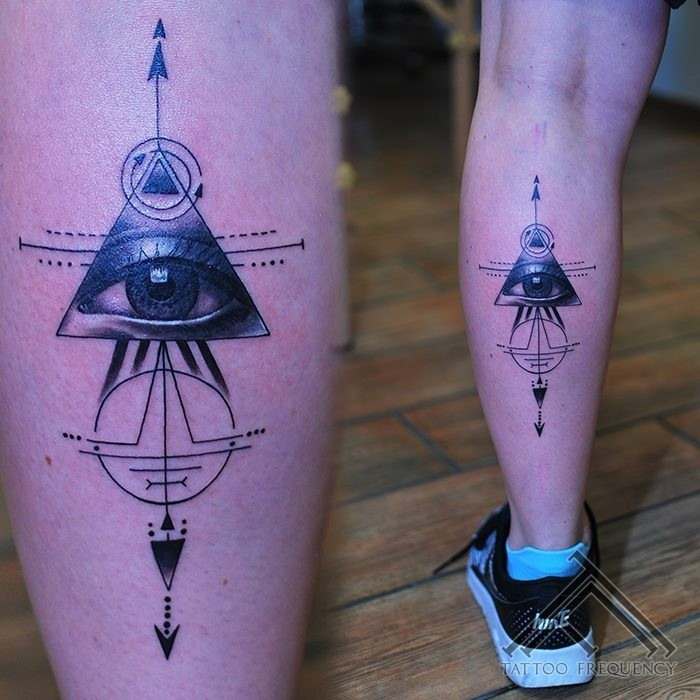 Cult style colored leg tattoo of mysterious ornaments