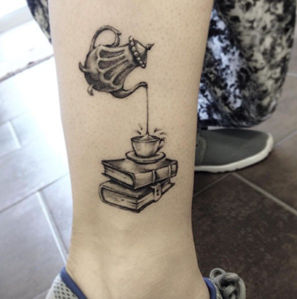 Cute 3D like black ink tea cup with books tattoo on ankle