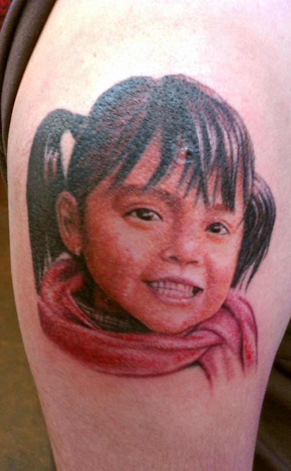 Cute 3D realistic lifelike colored photo like baby girl&quots portrait tattoo