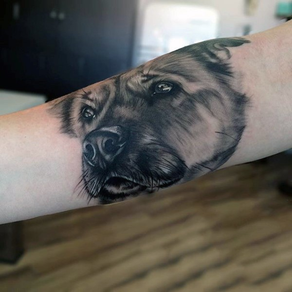 Cute 3D realistic naturally colored dog&quots portrait tattoo on arm