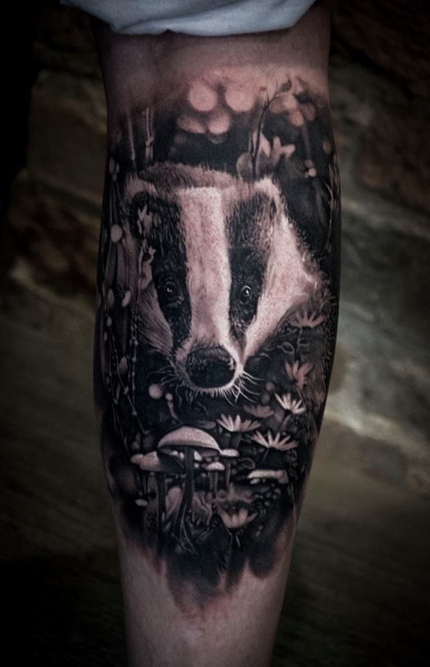 Cute badger in flowers and mushrooms tattoo on foream