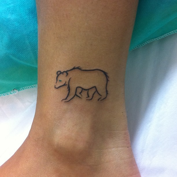 Cute bear shape tattoo on ankle idea for woman