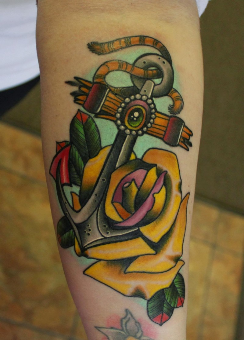 Cute big old school anchor with yellow rose tattoo on forearm ...