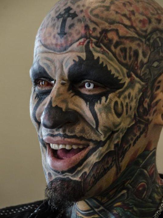 Cute black colored crazy face tattoos