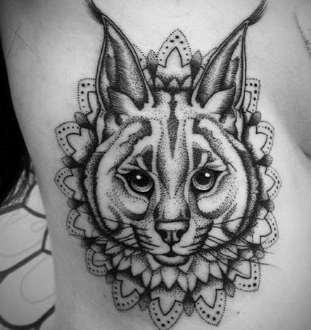 Cute black ink dot style side tattoo of caracal with floral ornament