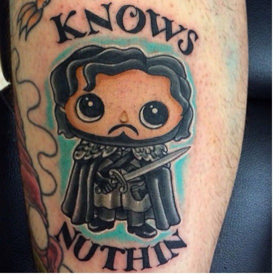 Cute cartoon like colored Game of Thrones hero tattoo with lettering