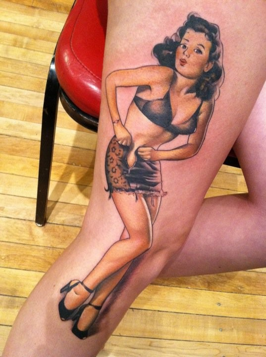 Cute cartoon like painted seductive woman tattoo on thigh