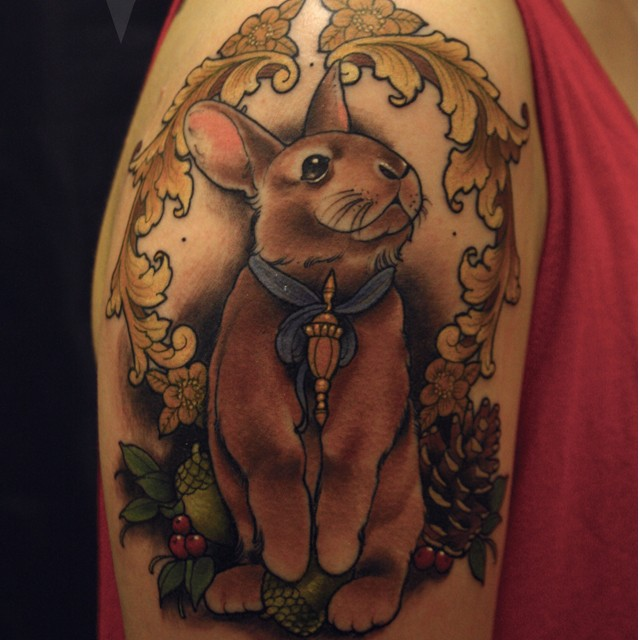 Cute cartoon style colored shoulder tattoo fo bunny with ribbon and berries