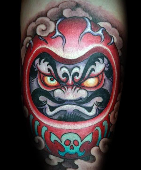 Cute colored fantasy evil daruma doll tattoo on leg