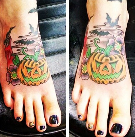 Cute colored little fantasy pumpkin tattoo on foot with flowers and bats